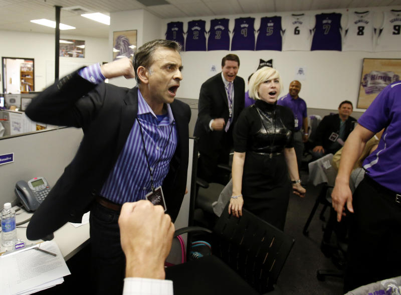 Vivek Ranadive, the new majority owner of the Sacramento Kings NBA basketball team, leads employees in a cheer during a visit to the team's offices at Sleep Train Arena in Sacramento, Calif., Thursday, May 23, 2013. Ranadive joined employees in calling season ticket holders to encourage them to renew their tickets for the next season.(AP Photo/Rich Pedroncelli)