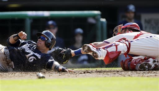 Milwaukee Brewers' Aramis Ramirez, left, is tagged out at home by Philadelphia Phillies catcher Erik Kratz while trying to score on a double by Logan Schafer in the fourth inning of a baseball game, Saturday, June 1, 2013, in Philadelphia. Schafer reached third on the play. (AP Photo/Matt Slocum)