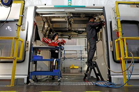 FILE PHOTO: An employee works on a new regional transport train at the Bombardier plant in Crespin, near Valenciennes, northern France, October 17, 2016. REUTERS/Benoit Tessier/File Photo