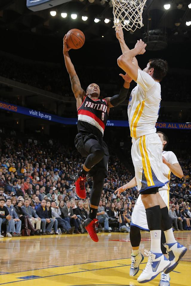 OAKLAND, CA - NOVEMBER 23: Damian Lillard #0 of the Portland Trail Blazers shoots against Andrew Bogut #12 of the Golden State Warriors on November 23, 2013 at Oracle Arena in Oakland, California. (Photo by Rocky Widner/NBAE via Getty Images)