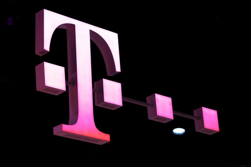 FILE PHOTO: A Deutsche Telekom logo at the Mobile World Congress in Barcelona, Spain, February 26, 2018. REUTERS/Yves Herman