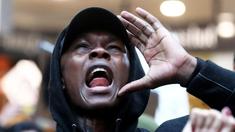 Seen here, Israel Adesanya was part of a George Floyd protest rally in Auckland.