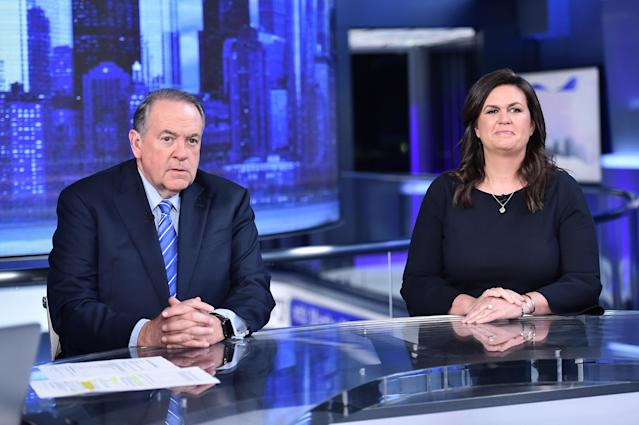 "Fox News contributors Mike Huckabee and his daughter Sarah Huckabee Sanders in an interview on ""The Story With Martha MacCallum"" on Sept. 17. (Photo: Steven Ferdman/Getty Images)"