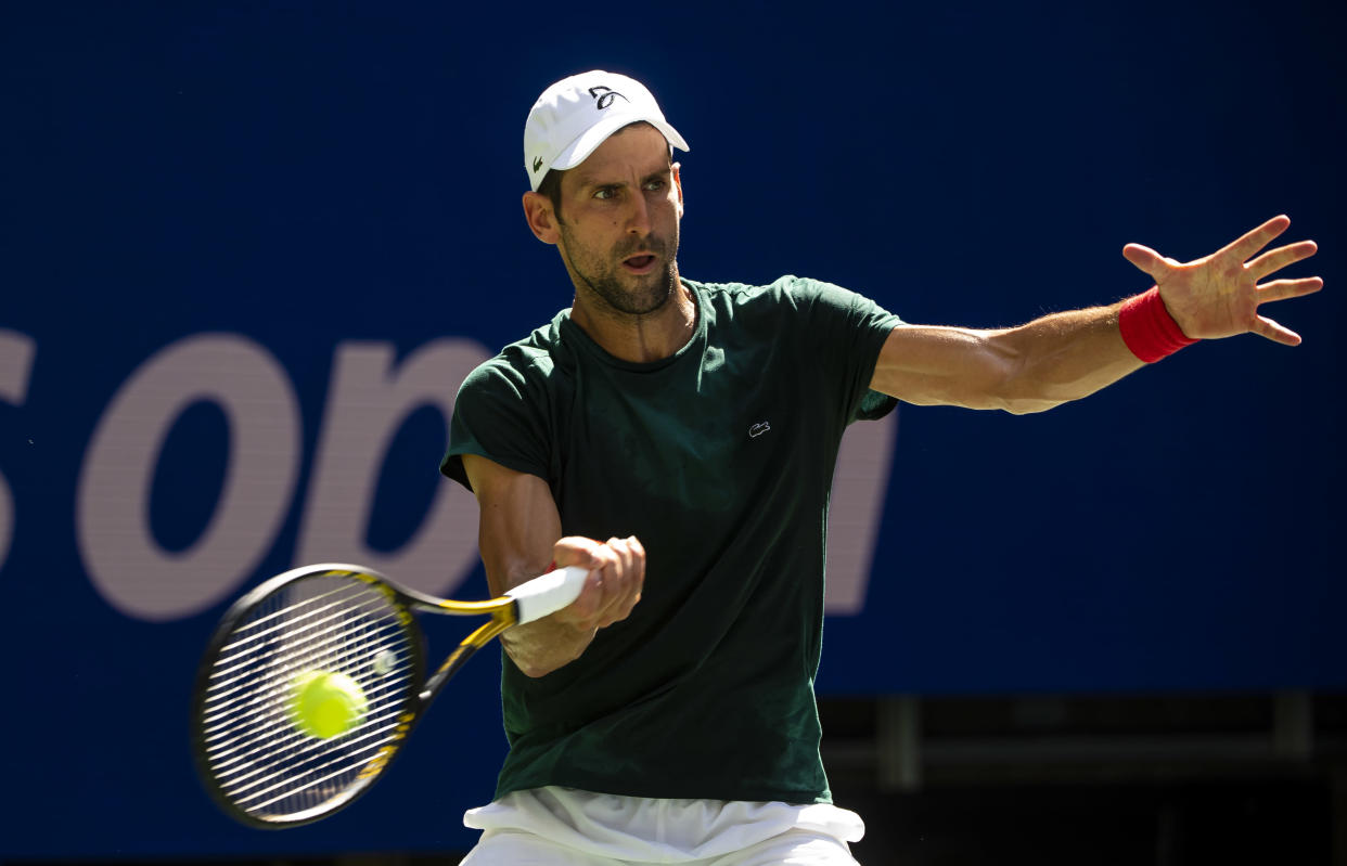 NEW YORK, NEW YORK - AUGUST 24: Novak Djokovic of Serbia practices with Casper Rudd of Norway before the start of the US Open at the USTA Billie Jean King National Tennis Center on August 24, 2021 in New York City. (Photo by TPN/Getty Images)