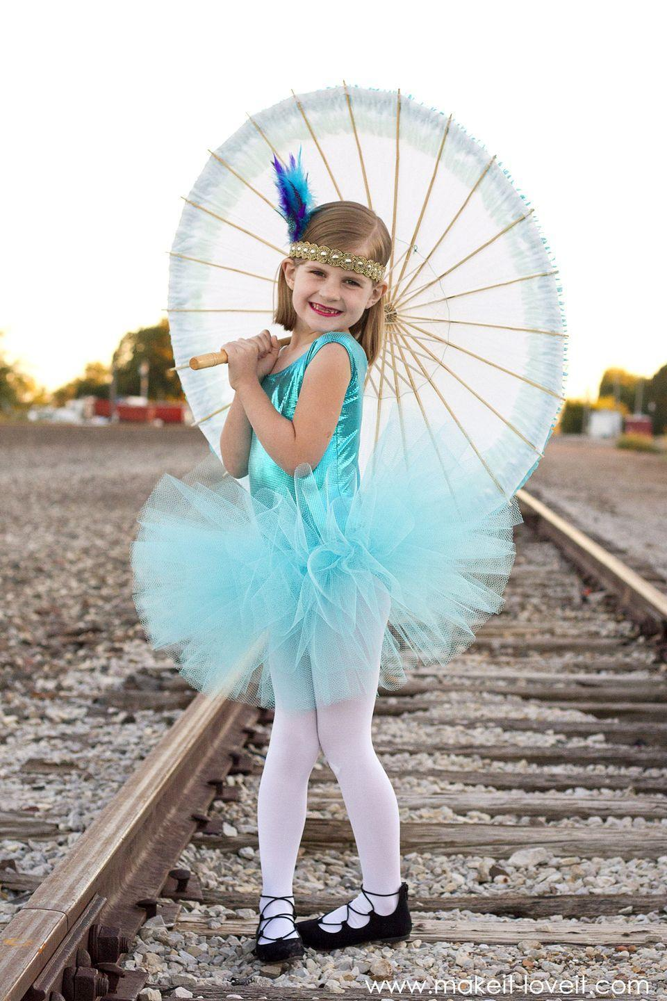"""<p>Your passionate performer will love this bright DIY costume, which features a stiff, thick tulle skirt for extra fluff. Remind her to practice her balancing act before the big show! </p><p><strong>See more at <a href=""""https://makeit-loveit.com/tight-rope-walker-circus-costume"""" rel=""""nofollow noopener"""" target=""""_blank"""" data-ylk=""""slk:Make It & Love It"""" class=""""link rapid-noclick-resp"""">Make It & Love It</a>. </strong></p><p><a class=""""link rapid-noclick-resp"""" href=""""https://www.amazon.com/Celine-lin-Feather-Wedding-6-8inch/dp/B01FU0RTMG?tag=syn-yahoo-20&ascsubtag=%5Bartid%7C10050.g.29402076%5Bsrc%7Cyahoo-us"""" rel=""""nofollow noopener"""" target=""""_blank"""" data-ylk=""""slk:SHOP FEATHERS"""">SHOP FEATHERS</a></p>"""