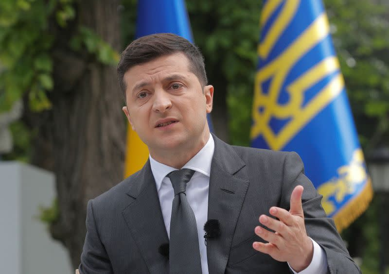 FILE PHOTO: Ukrainian President Volodymyr Zelenskiy gestures during an open-air news conference in Kiev