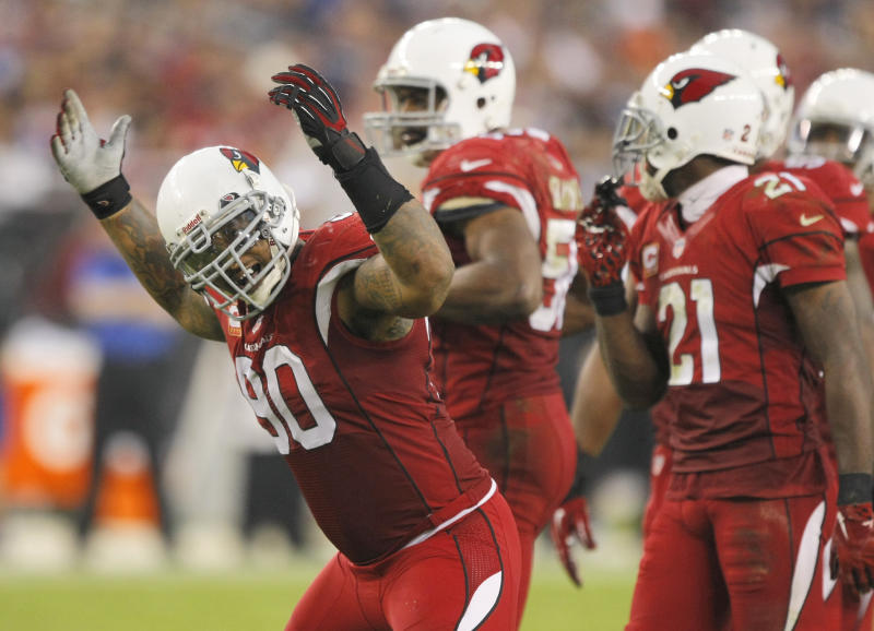 Arizona Cardinals defensive end Darnell Dockett (90) celebrates during the second half of an NFL football game against the Indianapolis Colts, Sunday, Nov. 24, 2013, in Glendale, Ariz. The Cardinals won 40-11. (AP Photo/Rick Scuteri)