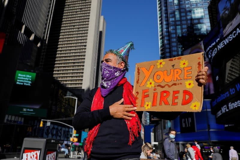 Joe Biden supporter Rene Calvo of New York City stands in Times Square awaiting election results, in Manhattan, New York City