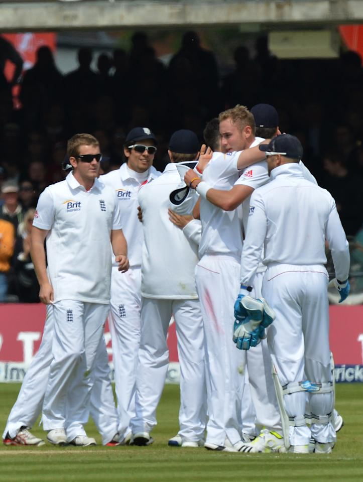 England players embrace following during the first test at Lord's Cricket Ground, London.