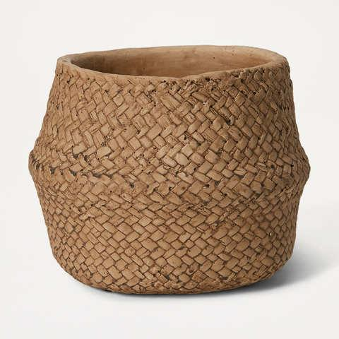 The budget retailer is selling the Woven Look Pot for $7.50 in the same range. Photo: Kmart