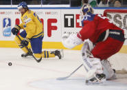 Sweden's forward Joel Lundqvist, left, attempts to score past Czech Republic goaltender Alexander Salak ring the bronze medal match between Sweden and Czech Republic at the Ice Hockey World Championship in Minsk, Belarus, Sunday, May 25, 2014. (AP Photo/Darko Bandic)