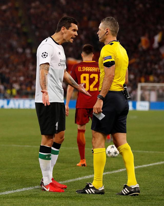 Soccer Football - Champions League Semi Final Second Leg - AS Roma v Liverpool - Stadio Olimpico, Rome, Italy - May 2, 2018 Liverpool's Dejan Lovren is shown a yellow card by referee Damir Skomina Action Images via Reuters/John Sibley