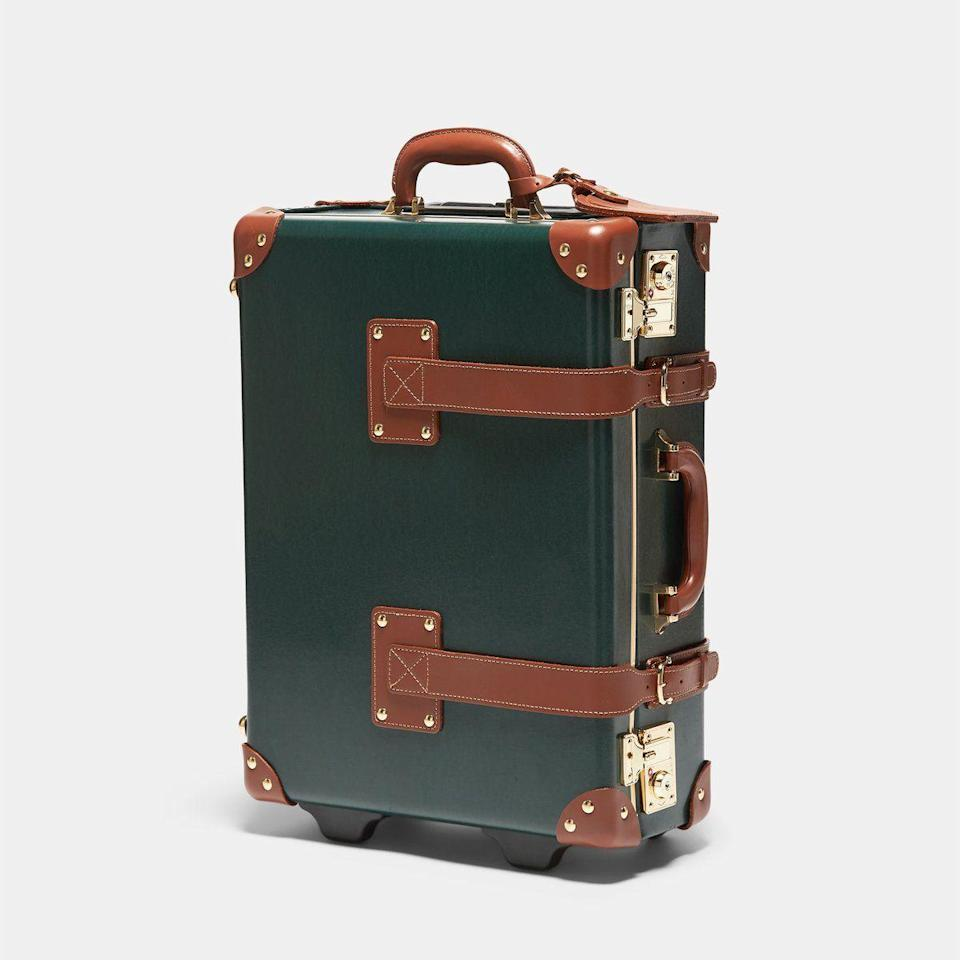 """<p><strong>Steamline Luggage</strong></p><p>steamlineluggage.com</p><p><strong>$850.00</strong></p><p><a href=""""https://steamlineluggage.com/collections/the-diplomat/products/the-diplomat-hunter-green-carryon"""" rel=""""nofollow noopener"""" target=""""_blank"""" data-ylk=""""slk:Shop Now"""" class=""""link rapid-noclick-resp"""">Shop Now</a></p><p>This holiday season I'm dreaming not only of travel, but also this gorgeous steamer trunk suitcase to tote with me.</p><p>- <em>Laurel Benedum, Market Editor</em></p>"""