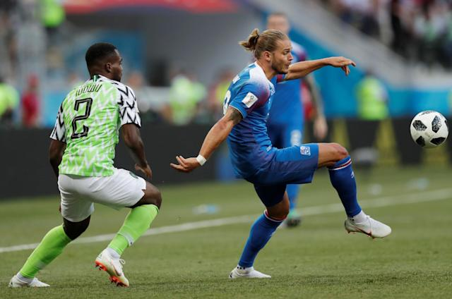 Soccer Football - World Cup - Group D - Nigeria vs Iceland - Volgograd Arena, Volgograd, Russia - June 22, 2018 Iceland's Rurik Gislason in action with Nigeria's Brian Idowu REUTERS/Ueslei Marcelino