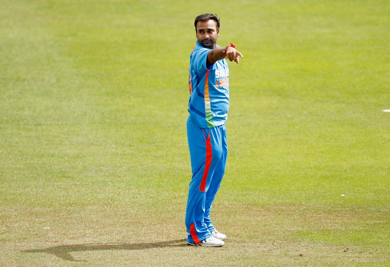 HOVE, ENGLAND - AUGUST 25: Amit Mishra of India gestures to his fielders during the one day tour match between Sussex and India at The County Ground on August 25, 2011 in Hove, England.  (Photo by Harry Engels/Getty Images)