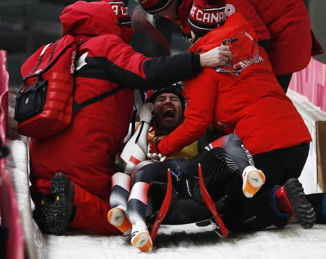 Luge - Pyeongchang 2018 Winter Olympic Games - Team Relay - Pyeongchang, South Korea - February 15, 2018 - Tristan Walker and Justin Snith of Canada celebrate with team mates after finishing. REUTERS/Edgar Su