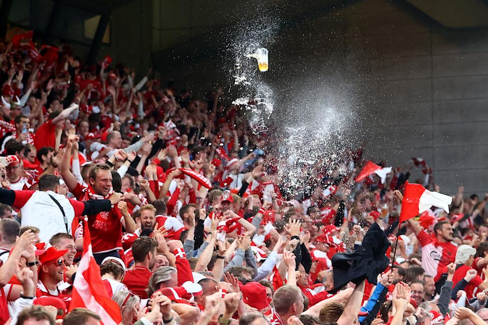 Seen here, Denmark fans celebrate their side's second goal scored by Yussuf Poulsen against Russia.