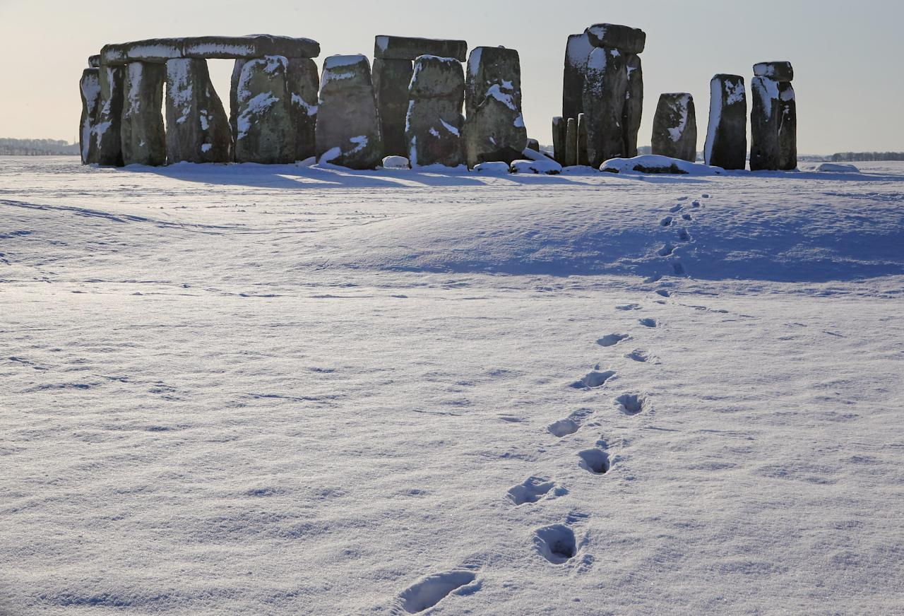 AMESBURY, UNITED KINGDOM - JANUARY 09:  Footsteps in the snow lead from the historic monument of Stonehenge on January 9 2010, in Wiltshire, England. The UNESCO world heritage site and one the UK's most popular tourist destinations has been closed due to the ice and snow on the approach paths and footways. Britain is continuing to be gripped by the Arctic weather and forecasters are predicting more snow in the next 24hrs and that the cold spell could last for at least another week.  (Photo by Matt Cardy/Getty Images)