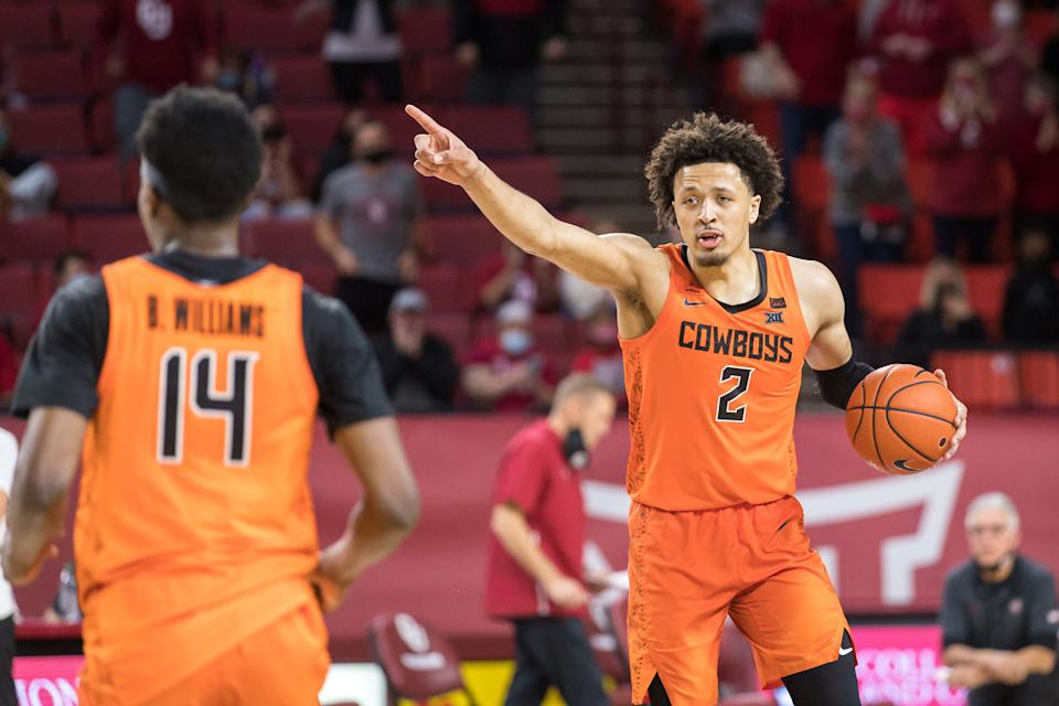 Oklahoma State Cowboys guard Cade Cunningham (2) calls a play during overtime against the Oklahoma Sooners on February 27th, 2021 at Lloyd Noble Center in Norman Oklahoma. (Photo by William Purnell/Icon Sportswire via Getty Images)