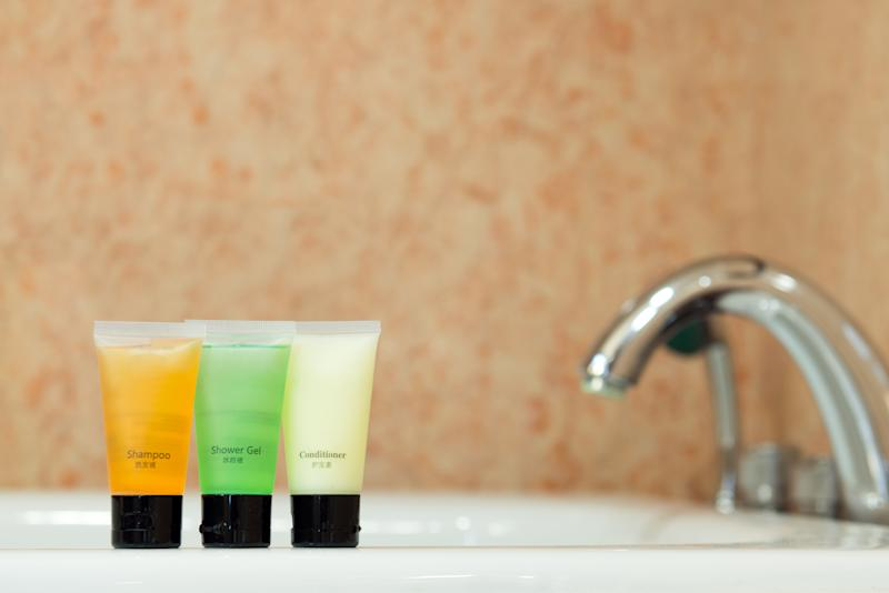 Set of toiletries placed at sink in the bathroom