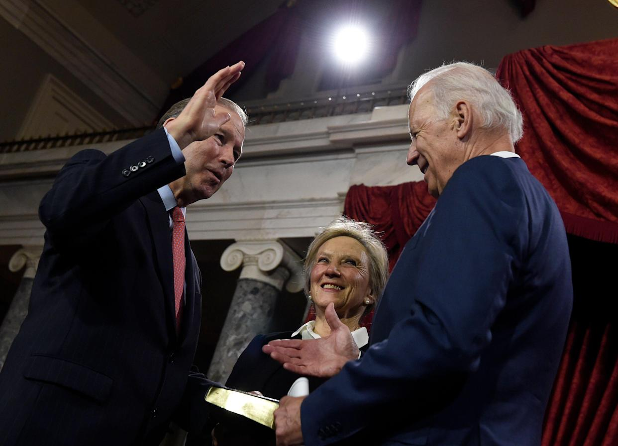 Sen. Tom Udall (D-N.M.) is considered a top contender to serve as President-elect Joe Biden's interior chief. Udall and then-Vice President Biden are pictured here during a ceremony in Washington in 2015. (Photo: ASSOCIATED PRESS)