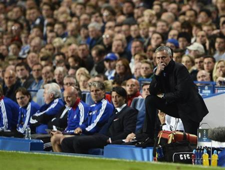 Chelsea's manager Mourinho watches team during Champions League soccer match against Basel at Stamford Bridge in London