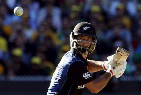New Zealand's Grant Elliott hits a boundary during the Cricket World Cup final match against Australia at the MCG