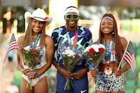 <p>Brittney Reese (C), first, Tara Davis (L), second, and Quanesha Burks, third, celebrate on the podium after the Women's Long Jump Final on day nine of the 2020 U.S. Olympic Track & Field Team Trials at Hayward Field on June 26, 2021 in Eugene, Oregon. (Photo by Patrick Smith/Getty Images)</p>