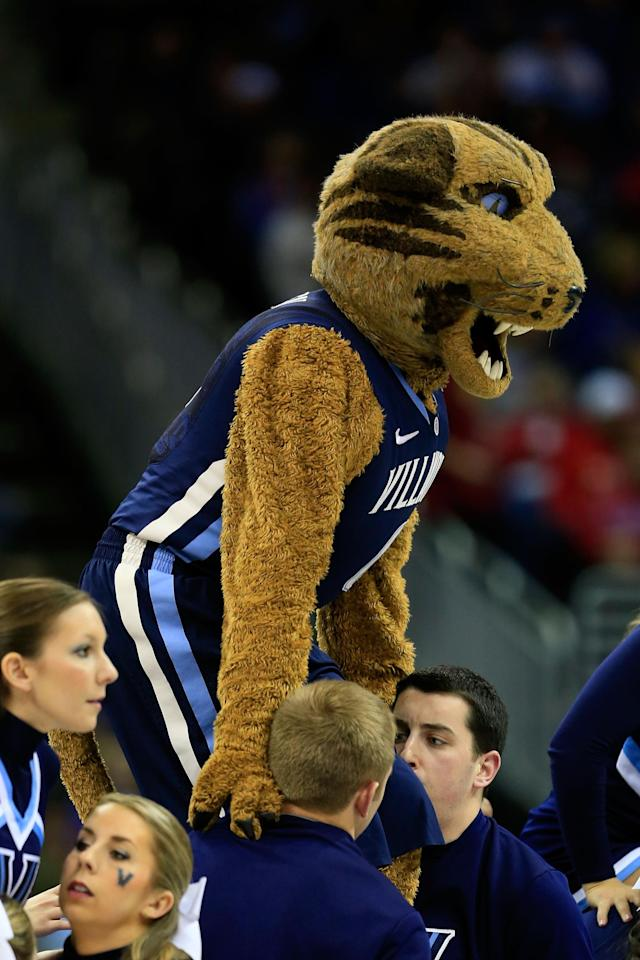 KANSAS CITY, MO - MARCH 22: The Villanova Wildcats cheerleaders hoist mascot Will D. Cat into the air in the first half against the North Carolina Tar Heels during the second round of the 2013 NCAA Men's Basketball Tournament at the Sprint Center on March 22, 2013 in Kansas City, Missouri. (Photo by Jamie Squire/Getty Images)