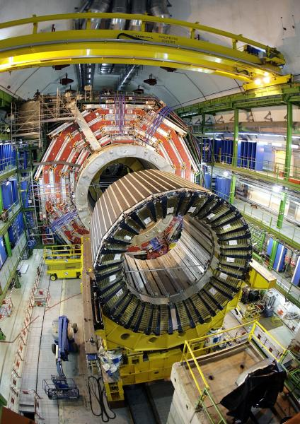"""FILE - In this March 22, 2007 file picture, the magnet core of the world's largest superconducting solenoid magnet (CMS, Compact Muon Solenoid), one of the experiments preparing to take data at European Organization for Nuclear Research (CERN)'s Large Hadron Collider (LHC) particle accelerator is seen, near Genva, Switzerland. The head of the world's biggest atom smasher is claiming discovery of a new particle that he says is consistent with the long-sought Higgs boson known popularly as the """"God particle"""" which is believed to give all matter in the universe size and shape. The results of the experiment will be announced Wednesday July 4, 2012. (AP Photo/Keystone/Martial Trezzini, File)"""