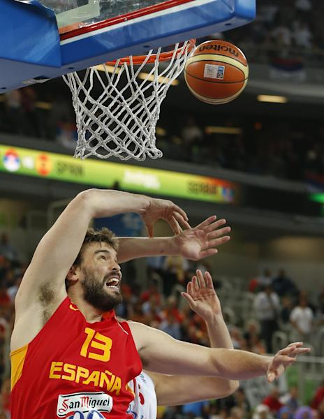 Spain's Marc Gasol fights for a rebound during the EuroBasket European Basketball Championship quarterfinal match against Serbia in Ljubljana, Slovenia, Wednesday, Sept. 18, 2013. (AP Photo/Petr David Josek)