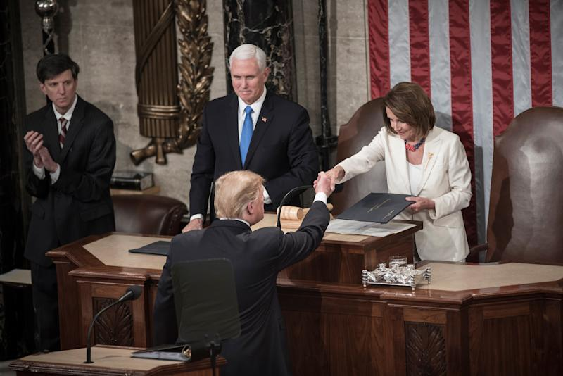 President Trump and House Speaker Nancy Pelosi shake hands at the State of the Union speech on Feb. 5, 2019.