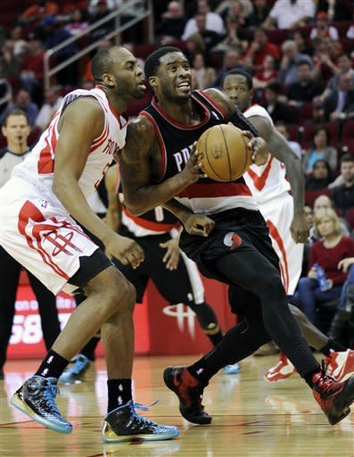 Portland Trail Blazers' Wesley Matthews, right, goes to the basket while pressured by Houston Rockets' James Anderson, left, in the first half of an NBA basketball game on Friday, Feb. 8, 2013, in Houston. (AP Photo/Pat Sullivan)