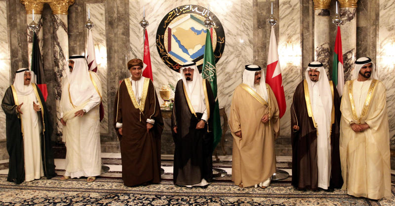 FILE - In this Tuesday, May 11, 2010 file photo, Arab gulf leaders from left to right, Kuwaiti Emir Sabah Al Ahmed Al Sabah, Qatari Emir Sheik Hamad bin Khalifa Al Thani, Omani Deputy Prime Minister Fahd bin Mahmoud Al Saeed, Saudi King Abdullah bin Abd al-Aziz, Bahraini King Hamad bin Isa Al Khalifa, Saudi Crown Prince Sultan bin Abdul Aziz and Sheikh Mohammed Bin Rashid Al Maktoum, Vice President and Prime Minister of the UAE and Ruler of Dubai pose for a group photo before the opening of the Gulf Cooperation Council (GCC) consultative summit in Riyadh, Saudi Arabia. Saudi Arabia, the United Arab Emirates and Bahrain said Wednesday, March 5, 2014 that they have recalled their ambassadors from the Gulf nation of Qatar over its alleged breach of a regional security deal in the clearest sign yet of the rift among Gulf Arab countries over Islamists in the region. Tensions have been brewing between Gulf countries and Qatar since Egyptians ousted President Hosni Mubarak and Qatar's massive financial and public support for his successor, Islamist President Mohammed Morsi, stood at odds with the UAE and Saudi Arabia's policies. (AP Photo/Hassan Ammar, File)