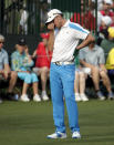 Jonas Blixt, of Sweden, reacts after his putt on the 15th green during the fourth round of the Masters golf tournament Sunday, April 13, 2014, in Augusta, Ga. (AP Photo/Charlie Riedel)