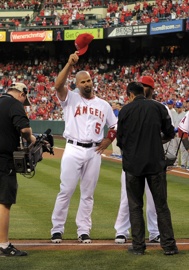 Los Angeles Angels' Albert Pujols tips his cap during introductions prior to a baseball game against the Kansas City Royals, Friday, April 6, 2012, in Anaheim, Calif. (AP Photo/Mark J. Terrill)