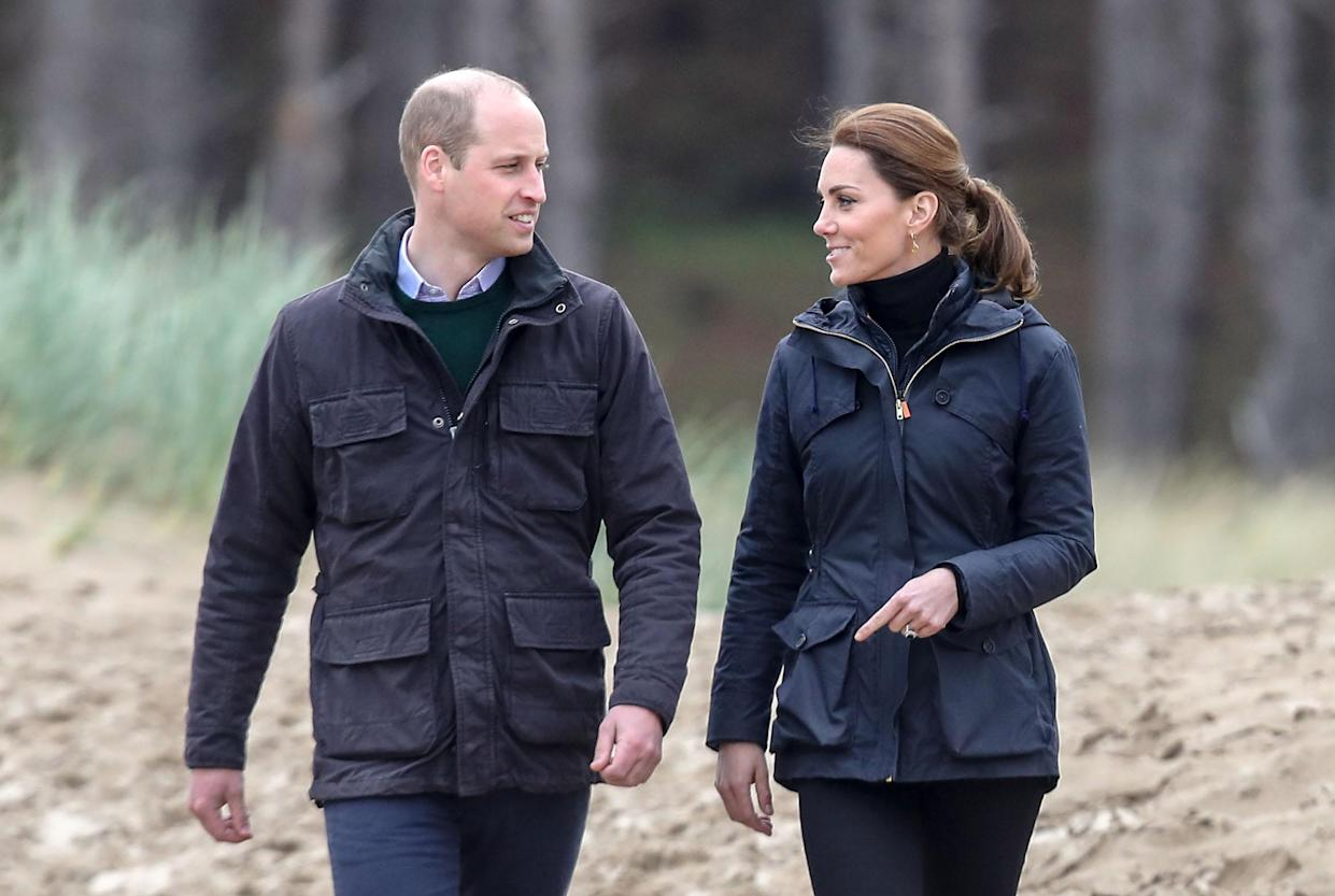 VARIOUS CITIES, - MAY 08: Prince William, Duke of Cambridge and Catherine, Duchess of Cambridge on a visit to Newborough Beach where they met the Menai Bridge Scouts and explored the beach's wildlife habitat. During a visit to North Wales on May 08, 2019 in Various Cities, United Kingdom. (Photo by Chris Jackson/Getty Images)