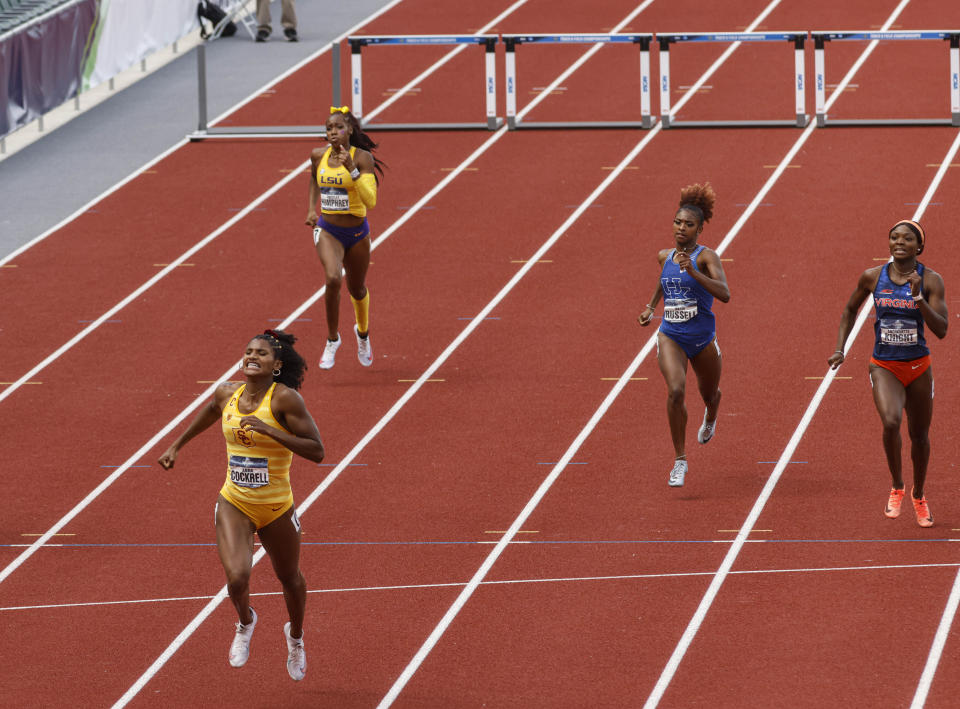 Southern California's Anna Cockrell wins the women's 400 hurdles during the NCAA Division I Outdoor Track and Field Championships, Saturday, June 12, 2021, at Hayward Field in Eugene, Ore. (AP Photo/Thomas Boyd)