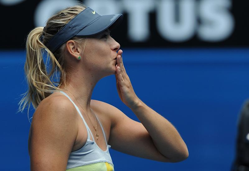 Russia's Maria Sharapova blows a kiss to the crowd following her win over compatriot Olga Puchkova in their first round match at the Australian Open tennis championship in Melbourne, Australia, Monday, Jan. 14, 2013. (AP Photo/Andrew Brownbill)