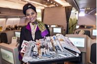 "<p>An Etihad Airways flight attendant passing out global newspapers aboard a flight from Washington D.C. to Abu Dhabi</p><p><strong>_________________________________________________________</strong><em><br><br><a href=""https://subscribe.hearstmags.com/subscribe/womansday/253396?source=wdy_edit_article"" rel=""nofollow noopener"" target=""_blank"" data-ylk=""slk:Subscribe to Woman's Day"" class=""link rapid-noclick-resp"">Subscribe to Woman's Day</a> today and get 73% off your first 12 issues. And while you're at it, <a href=""https://subscribe.hearstmags.com/circulation/shared/email/newsletters/signup/wdy-su01.html"" rel=""nofollow noopener"" target=""_blank"" data-ylk=""slk:sign up for our FREE newsletter"" class=""link rapid-noclick-resp"">sign up for our FREE newsletter</a> for even more of the Woman's Day content you want.</em><br></p>"