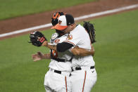 Baltimore Orioles catcher Pedro Severino left, embraces relief pitcher Tyler Wells after the team's baseball game against the Los Angeles Angels on Wednesday, Aug. 25, 2021, in Baltimore. (AP Photo/Terrance Williams)