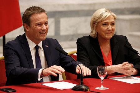 Marine Le Pen French National Front (FN) political party leader and candidate for French 2017 presidential election and Debout La France group former candidate Nicolas Dupont-Aignan attend a news conference in Paris