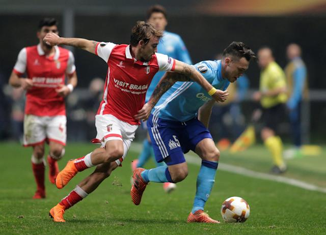 Soccer Football - Europa League Round of 32 Second Leg - S.C. Braga vs Olympique de Marseille - Estadio Municipal de Braga, Braga, Portugal - February 22, 2018 Marseille's Lucas Ocampos in action with Sporting Braga's Andre Horta REUTERS/Miguel Vidal