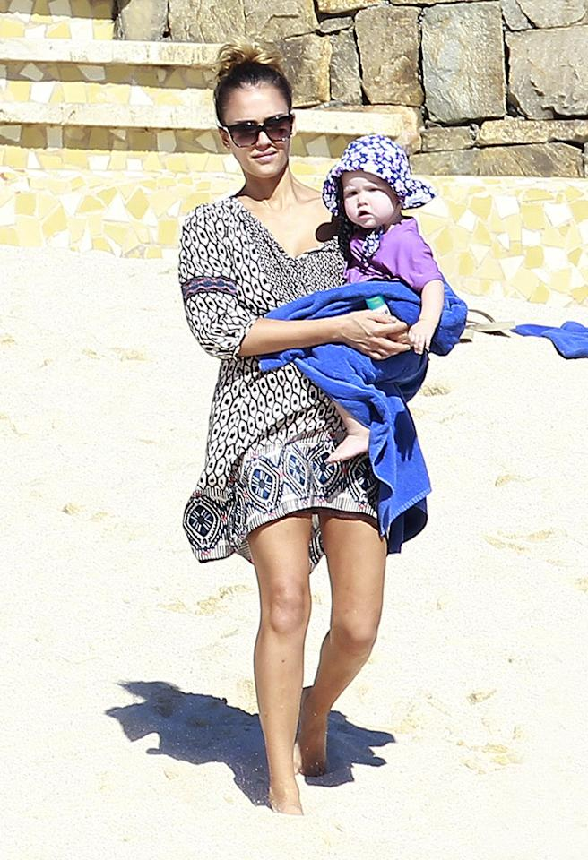 Jessica Alba and her family rang in the new year in Cabo San Lucas a few months back. And while she was snapped showing off her svelte post-baby bod much of the trip, on this particular occasion she stayed covered up as she carted then 16-month-old daughter Haven around the beach. (1/2/2013) <br /><br />