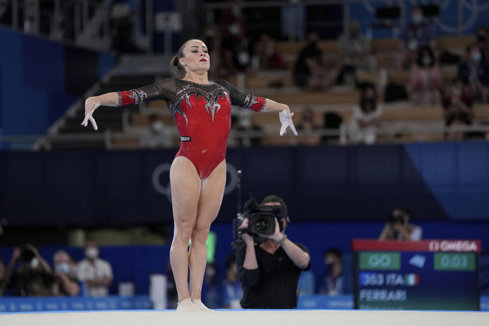 Vanessa Ferrari, of Italy, performs on the floor exercise during the artistic gymnastics women's apparatus final at the 2020 Summer Olympics, Monday, Aug. 2, 2021, in Tokyo, Japan. (AP Photo/Ashley Landis)