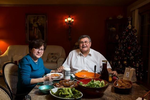Rina and Giuseppe eat dinner in Wisconsin. (LOIS BIELEFELD)