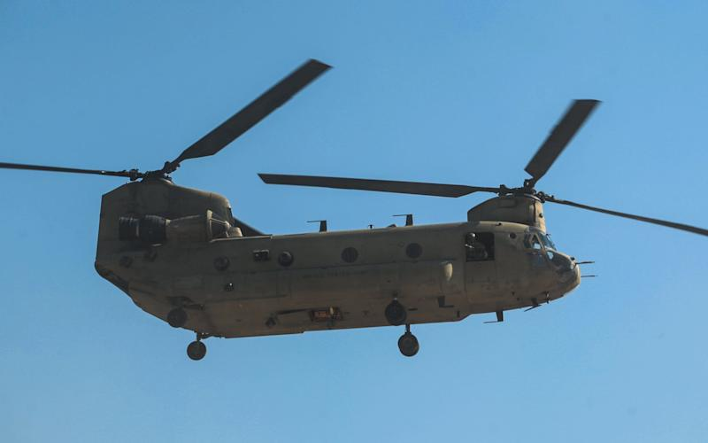 A Chinook helicopter, like that involved in the near collision with the drone - Credit: AHMAD AL-RUBAYE/AFP/Getty Images