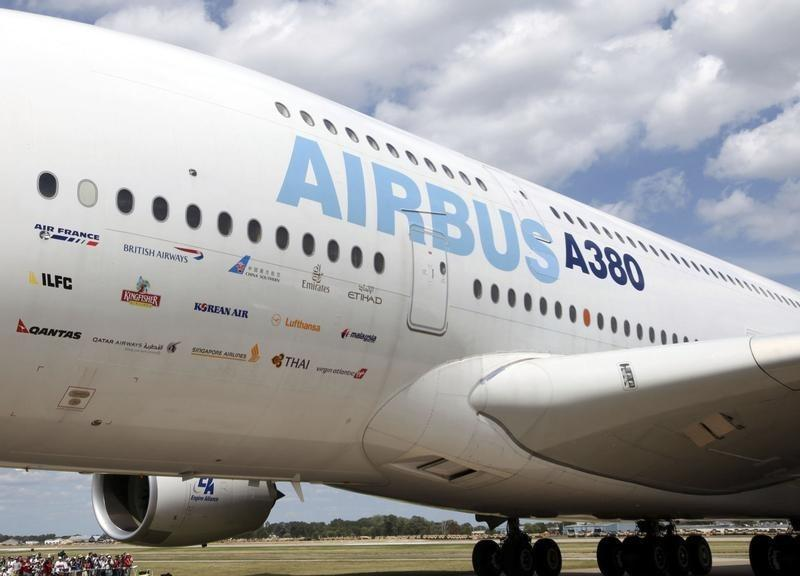 An Airbus-380 displays signage from the airlines that fly the aircraft at the EAA convention in Oshkosh