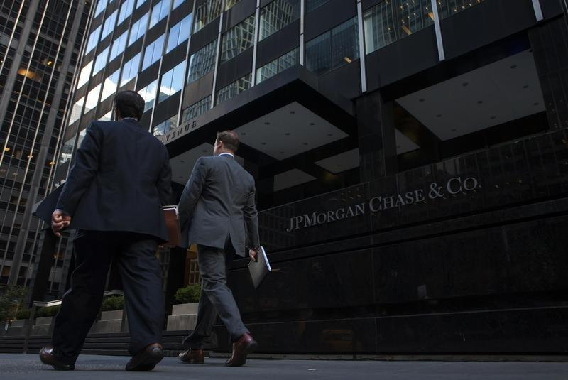 People walk by the JP Morgan & Chase Co. building in New York