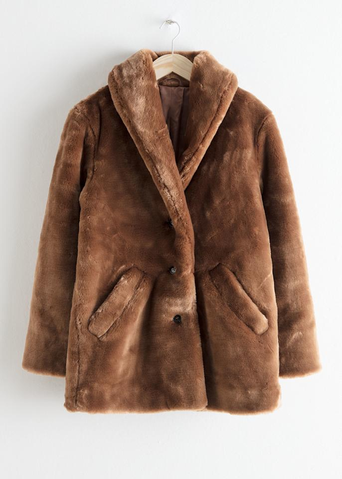 "$149, & Other Stories. <a href=""https://www.stories.com/en_usd/clothing/jackets-coats/fauxfur/product.short-faux-fur-coat-brown.0657991001.html"">Get it now!</a>"